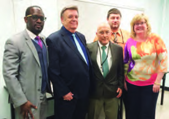 Food Service Supervisors at a grievance hearing pictured with Mal Patterson, Director of Hearings and Grievances (second from the left), Jerry Simmons, Sidney Grabill, Chris Maniace and Kelly Bacci.